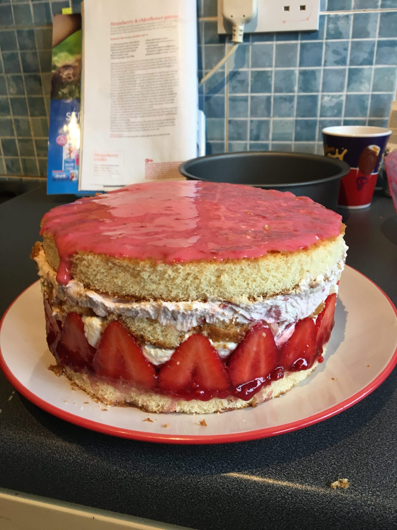 Strawberry and elderflower gateau with strawberry coulis