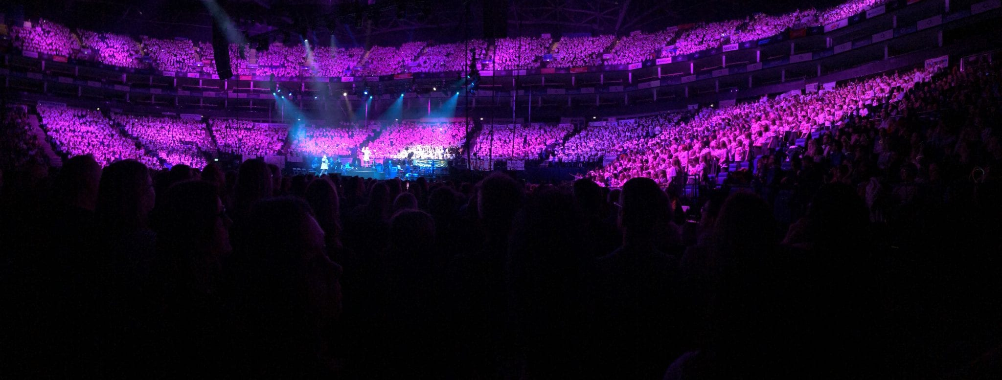 Panoramic picture of school choir singing at O2 London