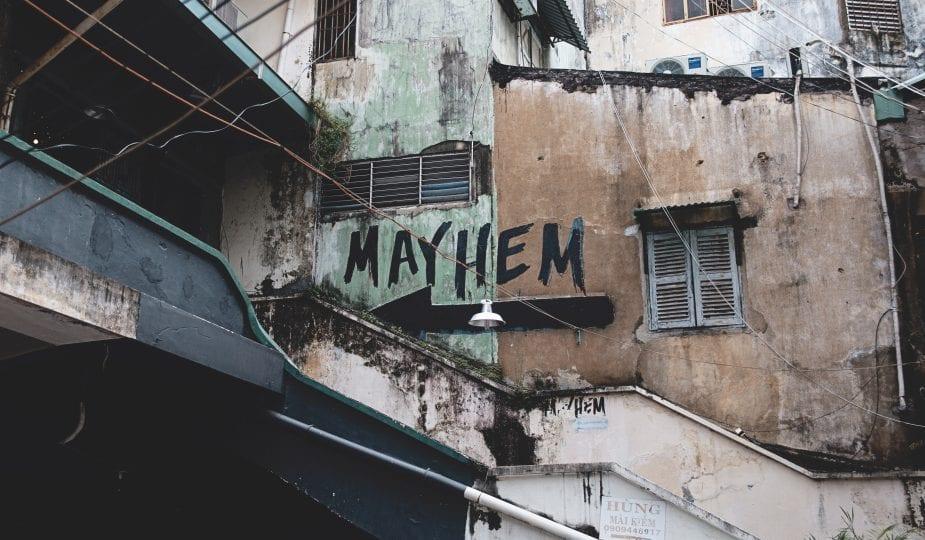 mayhem, painted on a run down building