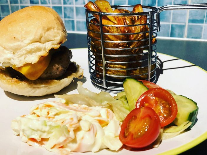 Pork and apple burger, served with potato wedges, Chucky slaw and side salad dressed in balsamic vinegar